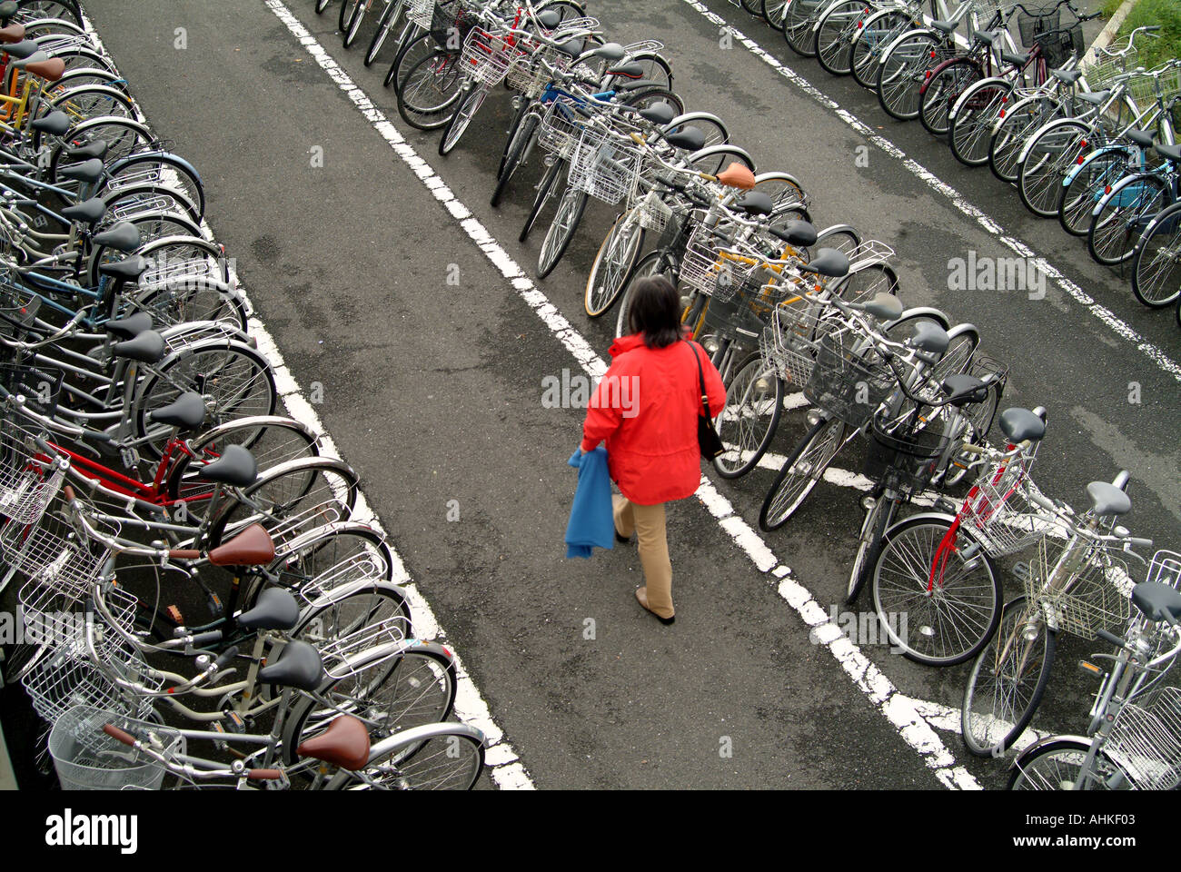 Woman in a bicycle park Kyoto Japan - Stock Image