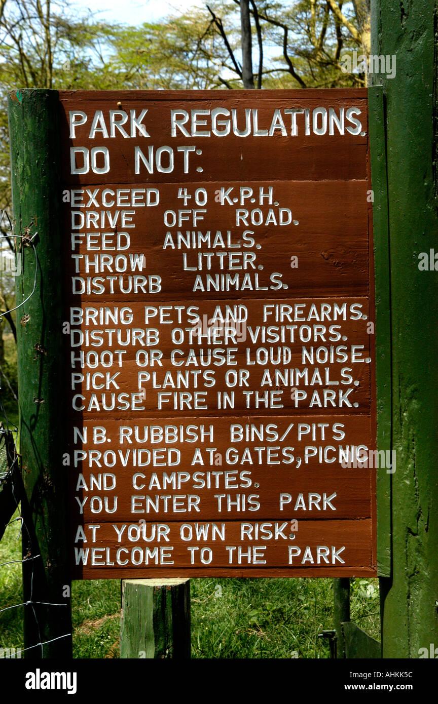 Africa Kenya Tanzania park regulations  sign - Stock Image