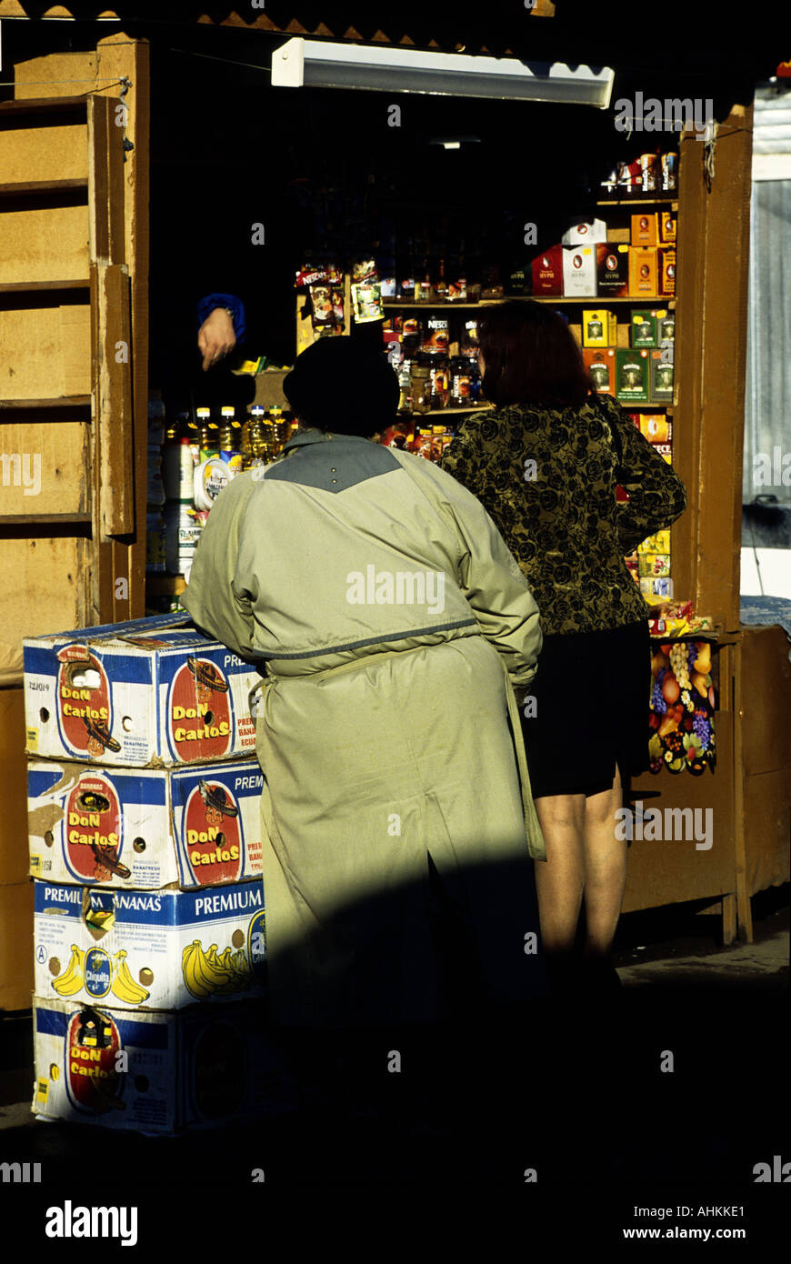 Shopping at a kiosk in the Market Place Trading Arcade, Kostrama, Russia - Stock Image