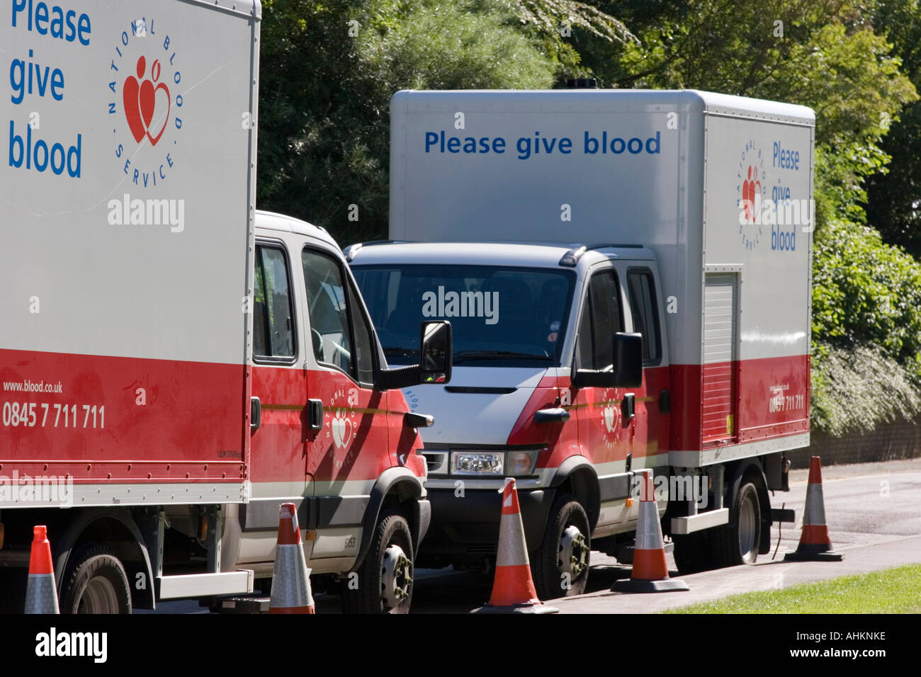 National blood transfusion service lorries in corporate car park - Stock Image