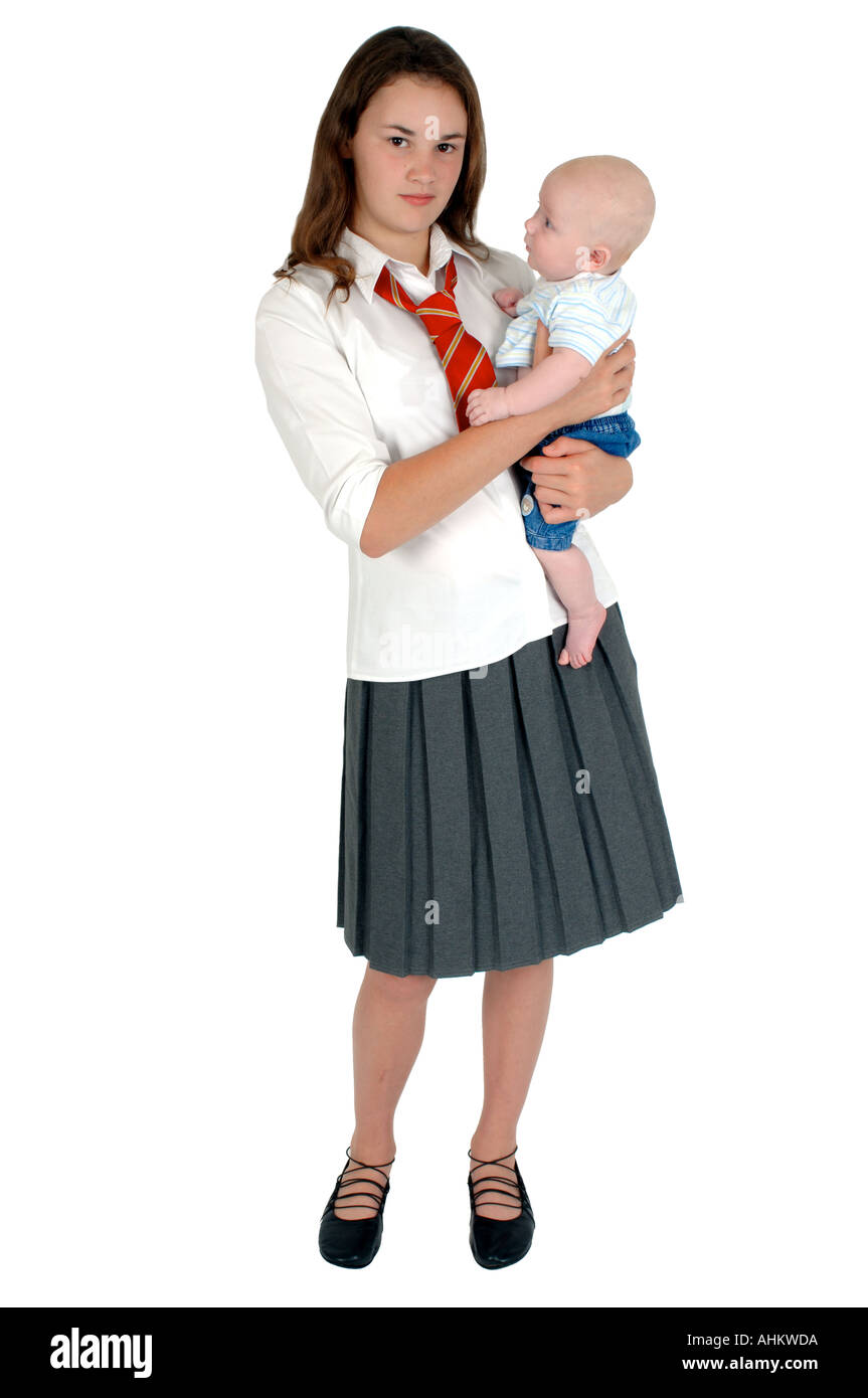 A Young Teenage Mum In School Uniform Holding Her Baby