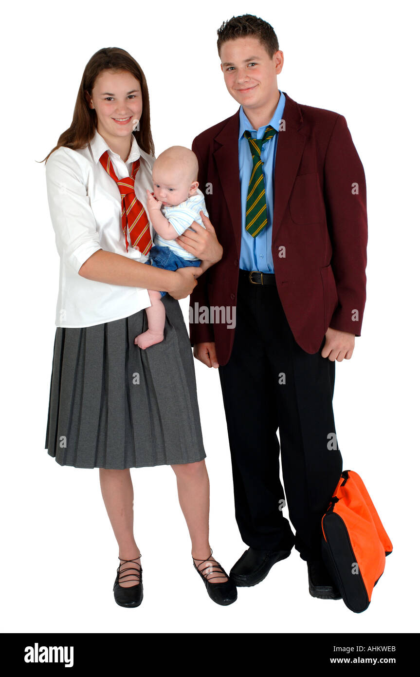 A Young Teenage Mum And Dad In School Uniform Holding Their Baby