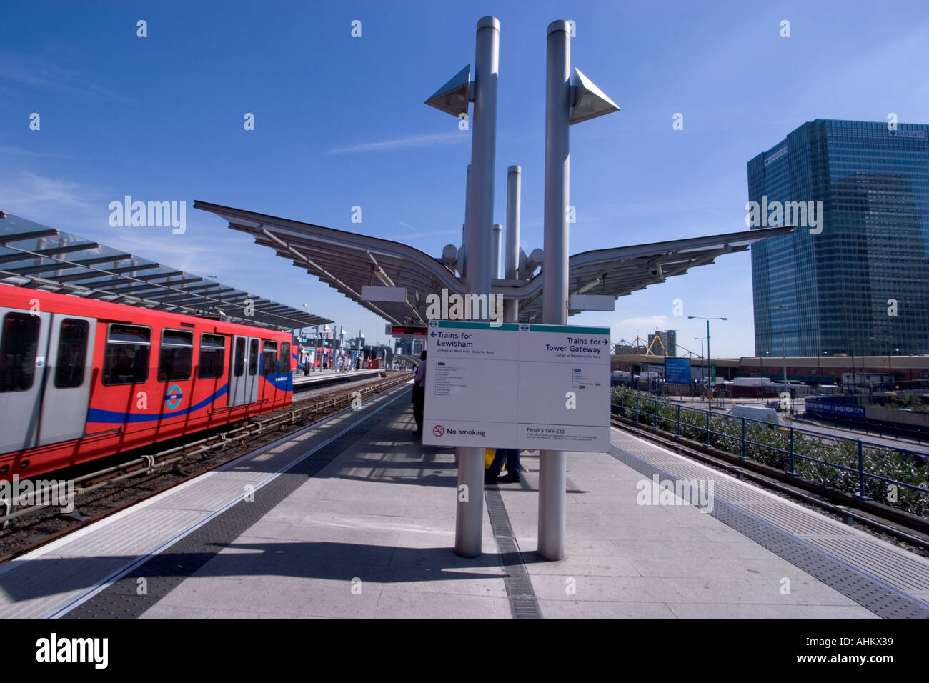 View of DLR Docklands light railway station with train Poplar Station - Stock Image