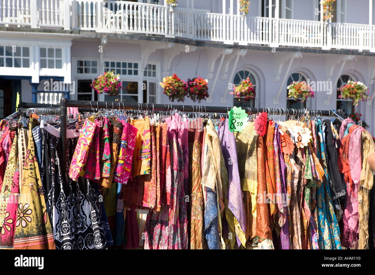 Skirts for sale on a rail on Sidmouth seafront during International Festival Devon England - Stock Image