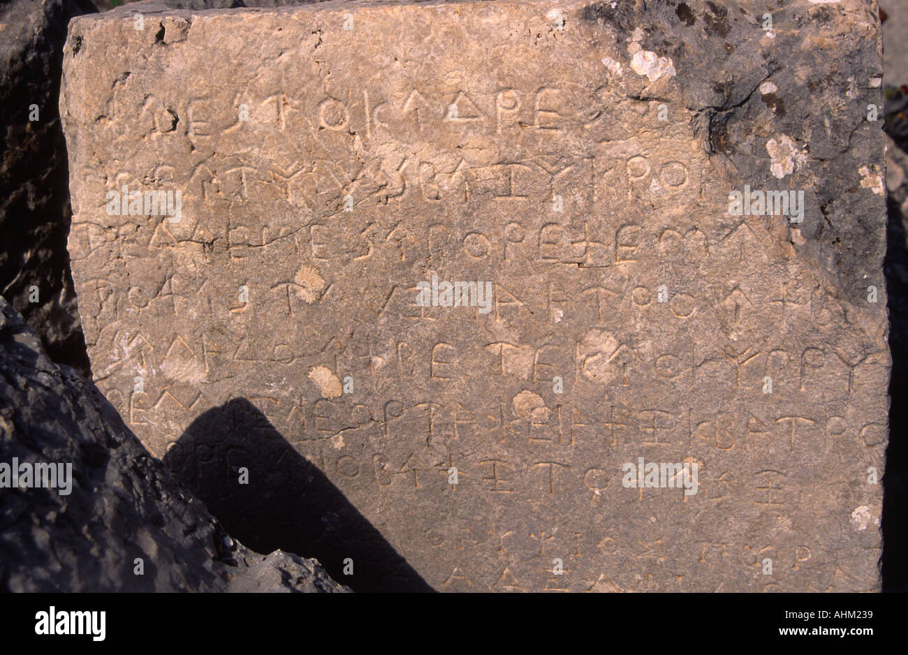 Ancient Greek writing carved on stone Tlos Turkey - Stock Image