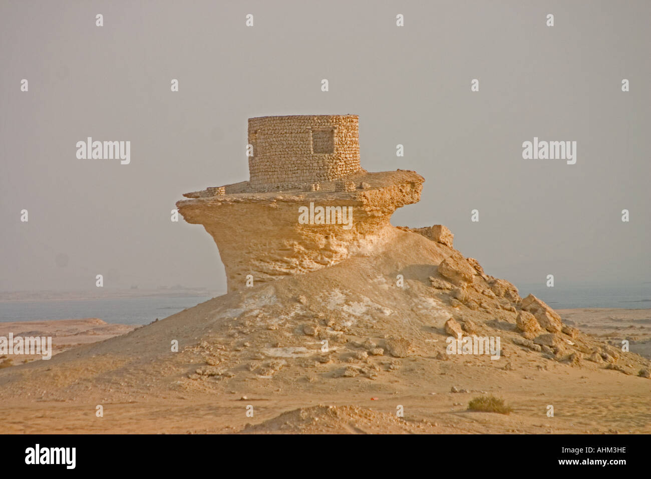 a shelter on a mushroom rock in qatar - Stock Image