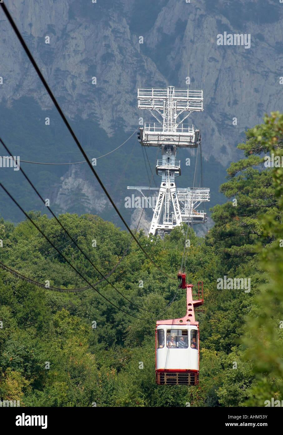cable car above a wood crimea mountain ajpetri - Stock Image