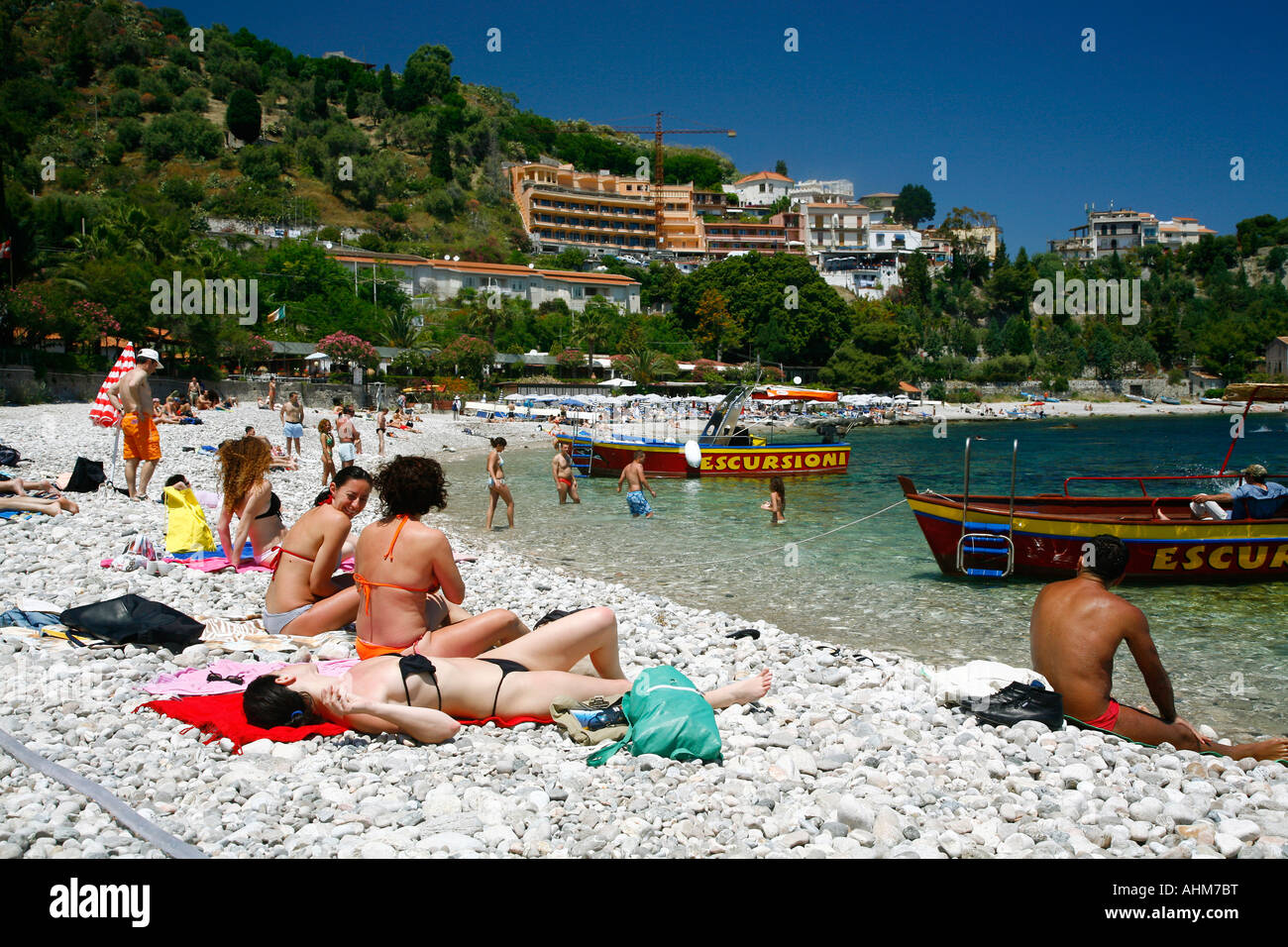 People on the beach at Isola Bella island Taormina Sicliy - Stock Image