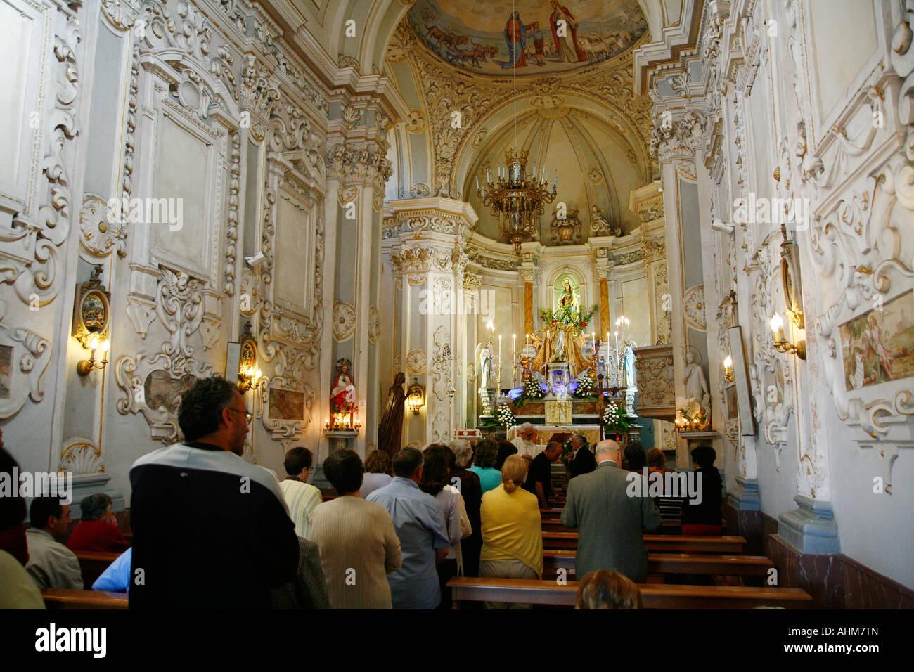 People attending sunday mass at San Giuseppe church Taormina Sicily - Stock Image