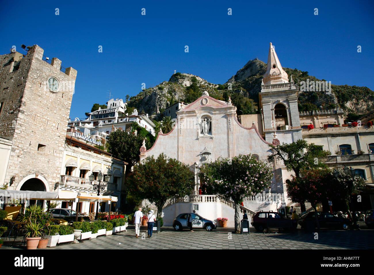 Piazza IX april with San Giuseppe church and the Mezzo gate Taormina Sicily Italy - Stock Image
