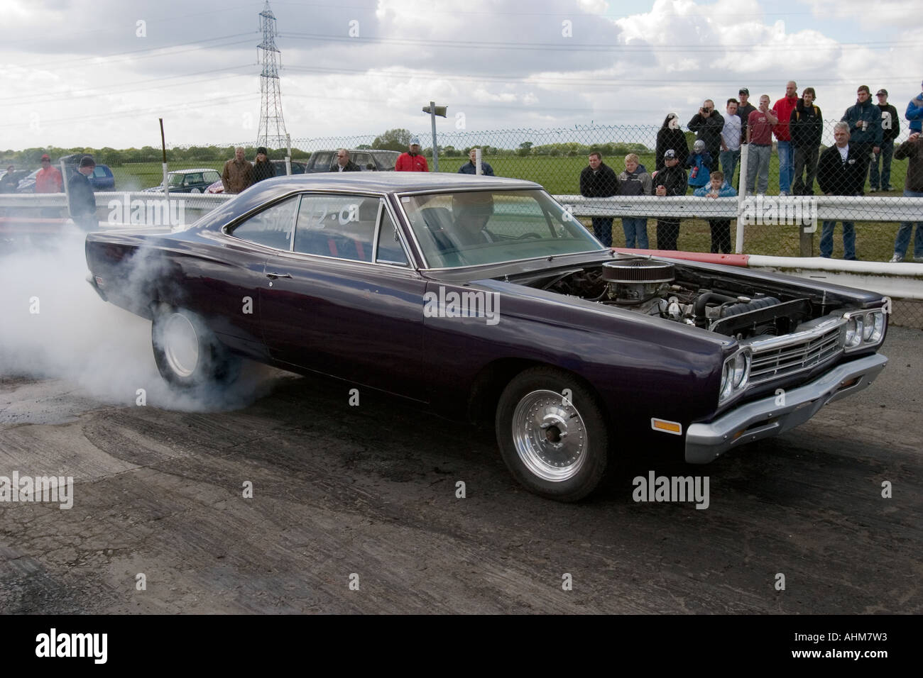 Heavily modified American muscle car doing a burnout prior to a drag ...