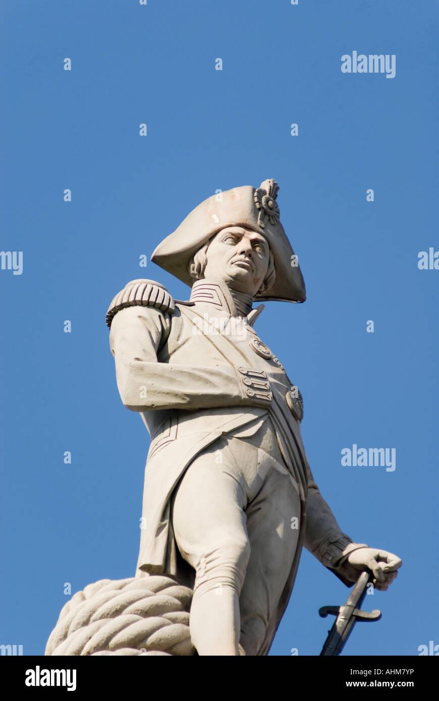 Statue of Nelson on top of Nelson's Column in Trafalgar Square London UK - Stock Image