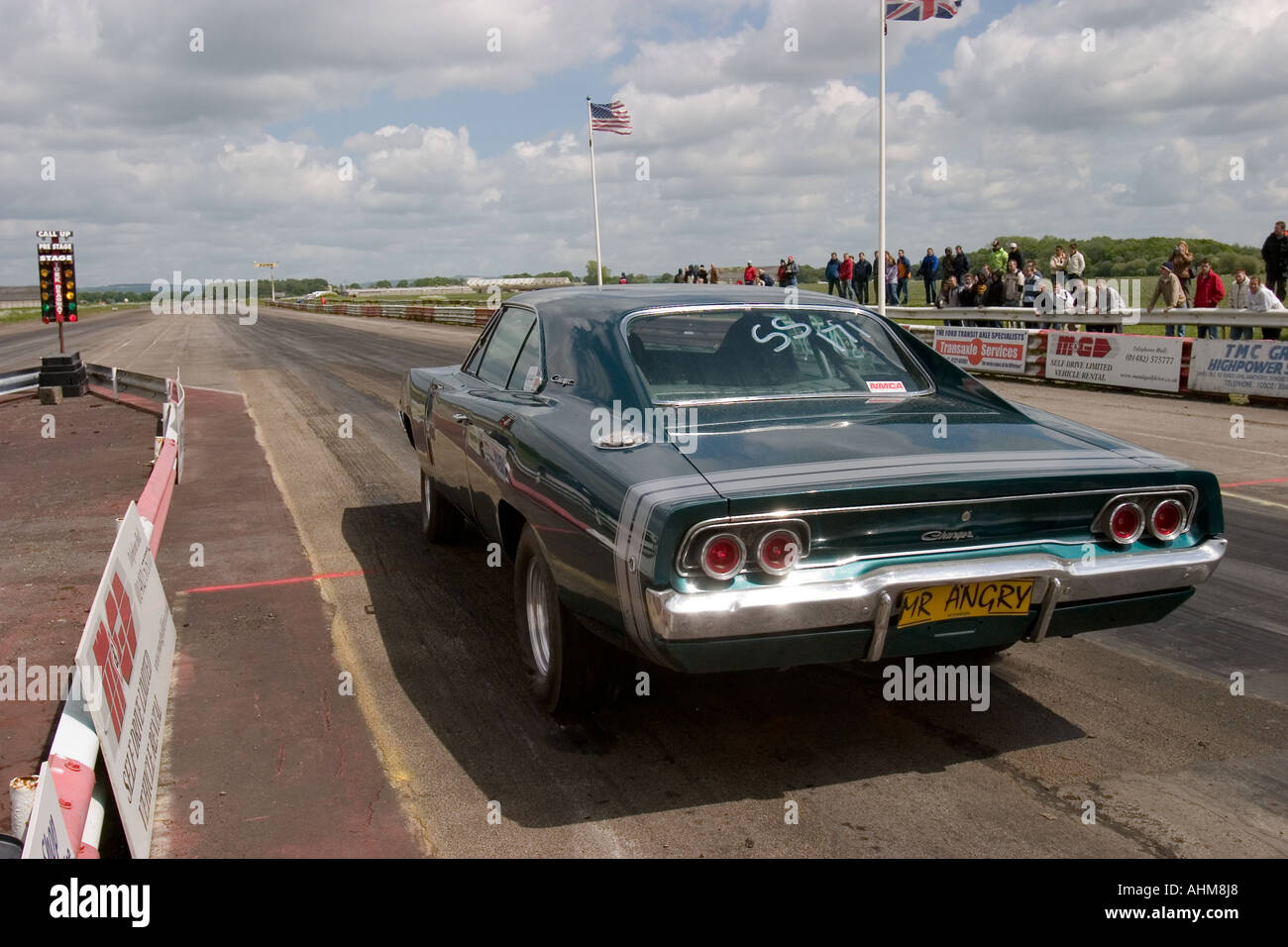 Heavily modified American muscle car on start line at drag race ...