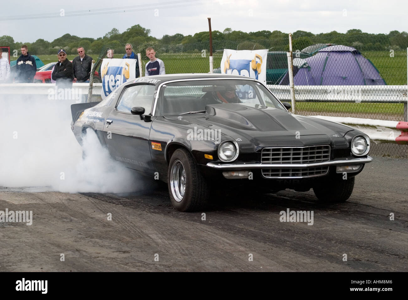 American Muscle Car Doing Burnout Before Start Of Drag Race Stock