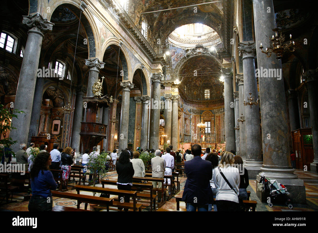 People attending a mass at San Giuseppe dei Teatini church Palermo Sicily - Stock Image