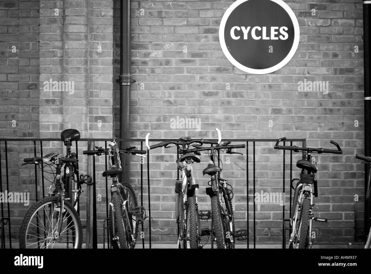 Bike rack cycle park green transport zero 0 emission vehicle pollution local journey mountain bike travel lock Stock Photo