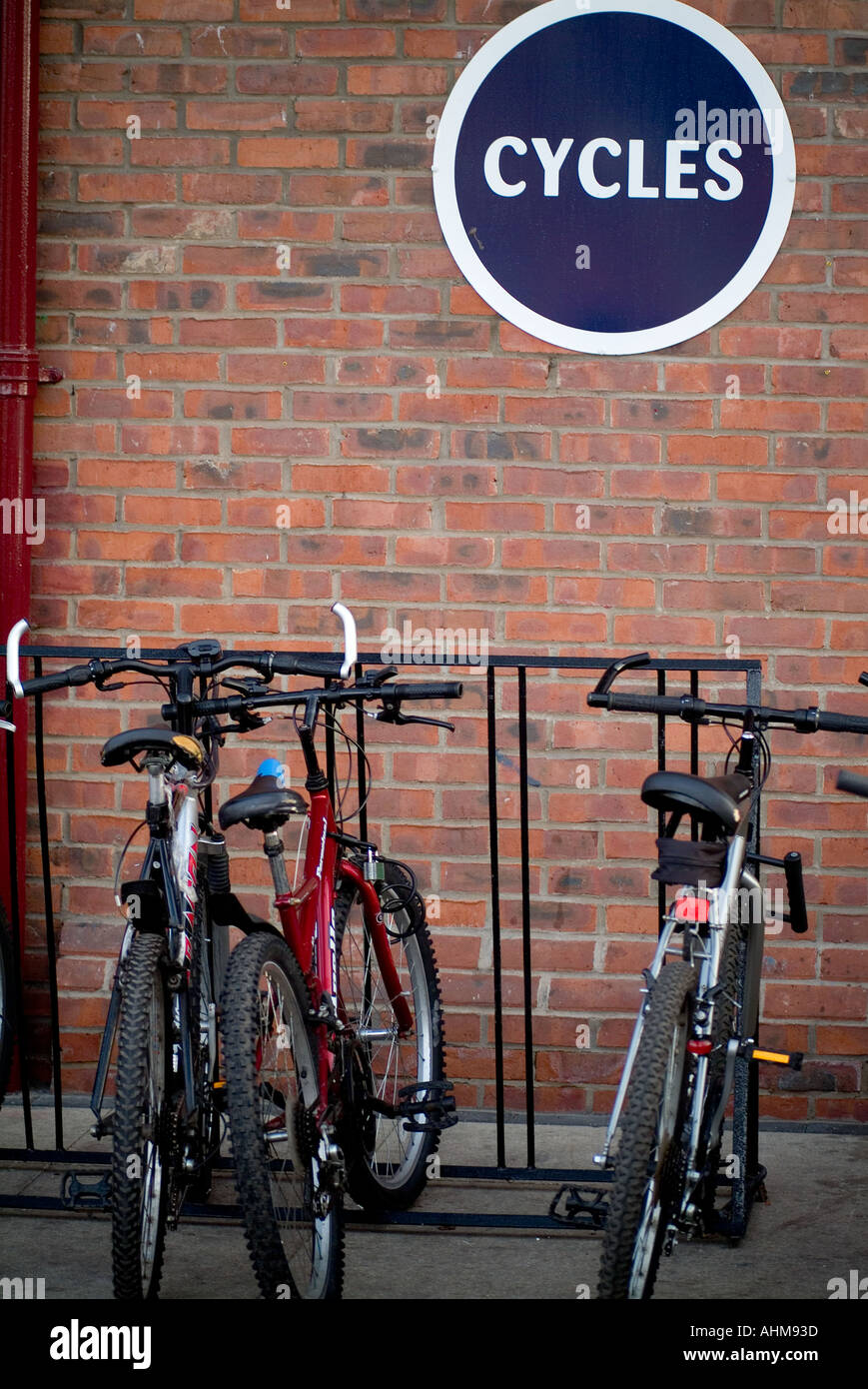 bike rack cycle park green transport zero 0 emmission vechical pollution local journey mountain bike travel lock Stock Photo