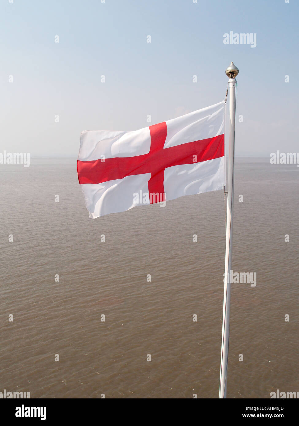 The red cross of St George, the English flag flying at Clevedon Pier, North Somerset. - Stock Image