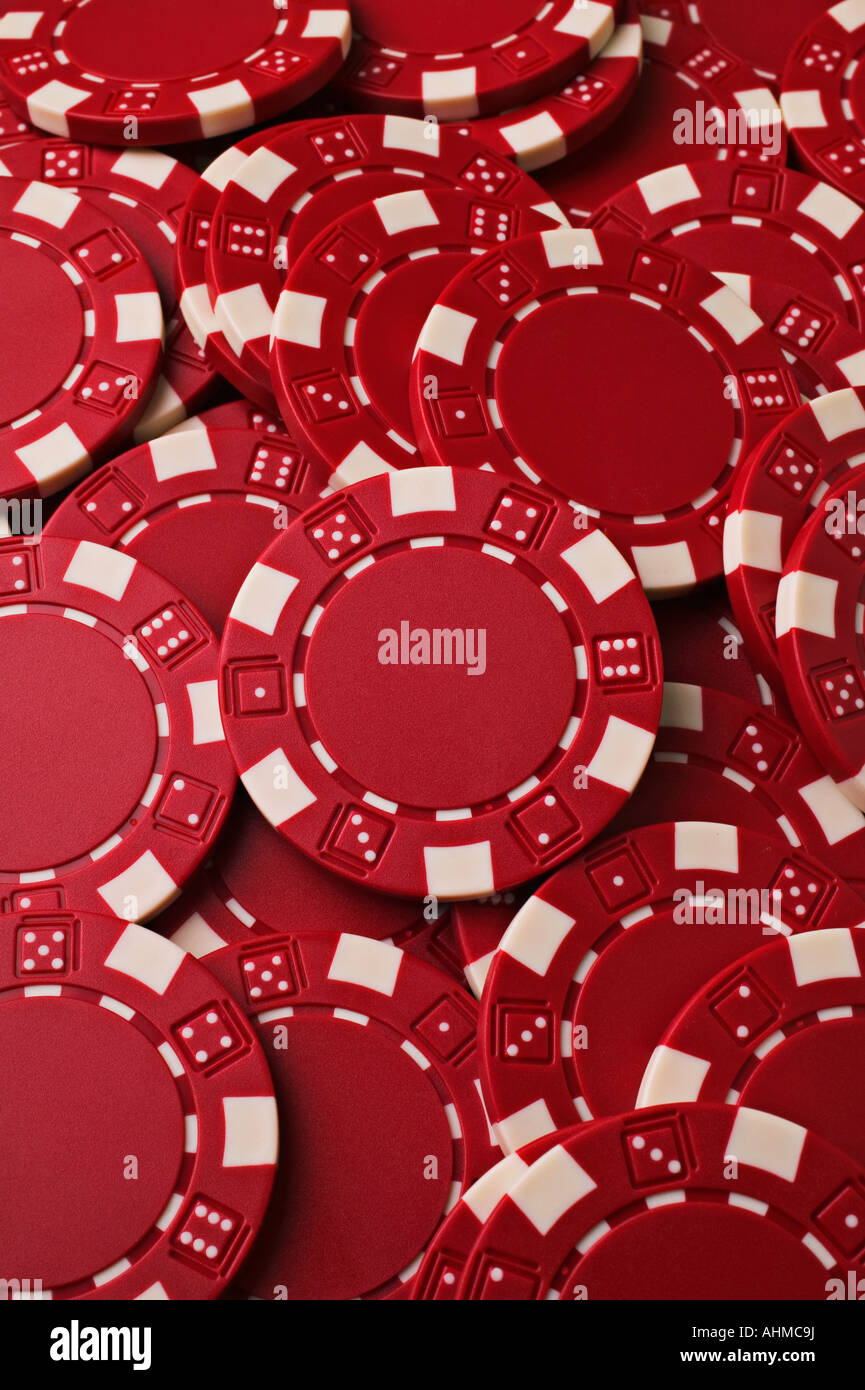 A pile of red casino chips - Stock Image
