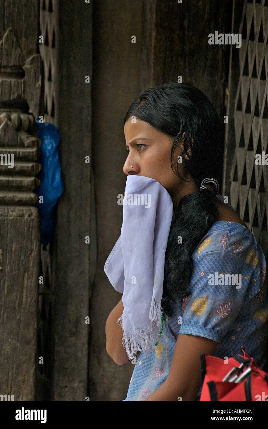Nepalese woman shielding her mouth with a silk shawl Durbar Square Kathmandu Nepal - Stock Image