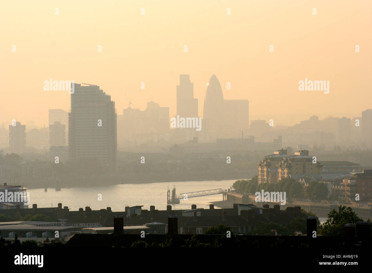 Smoggy view over the River Thames and London UK - Stock Image
