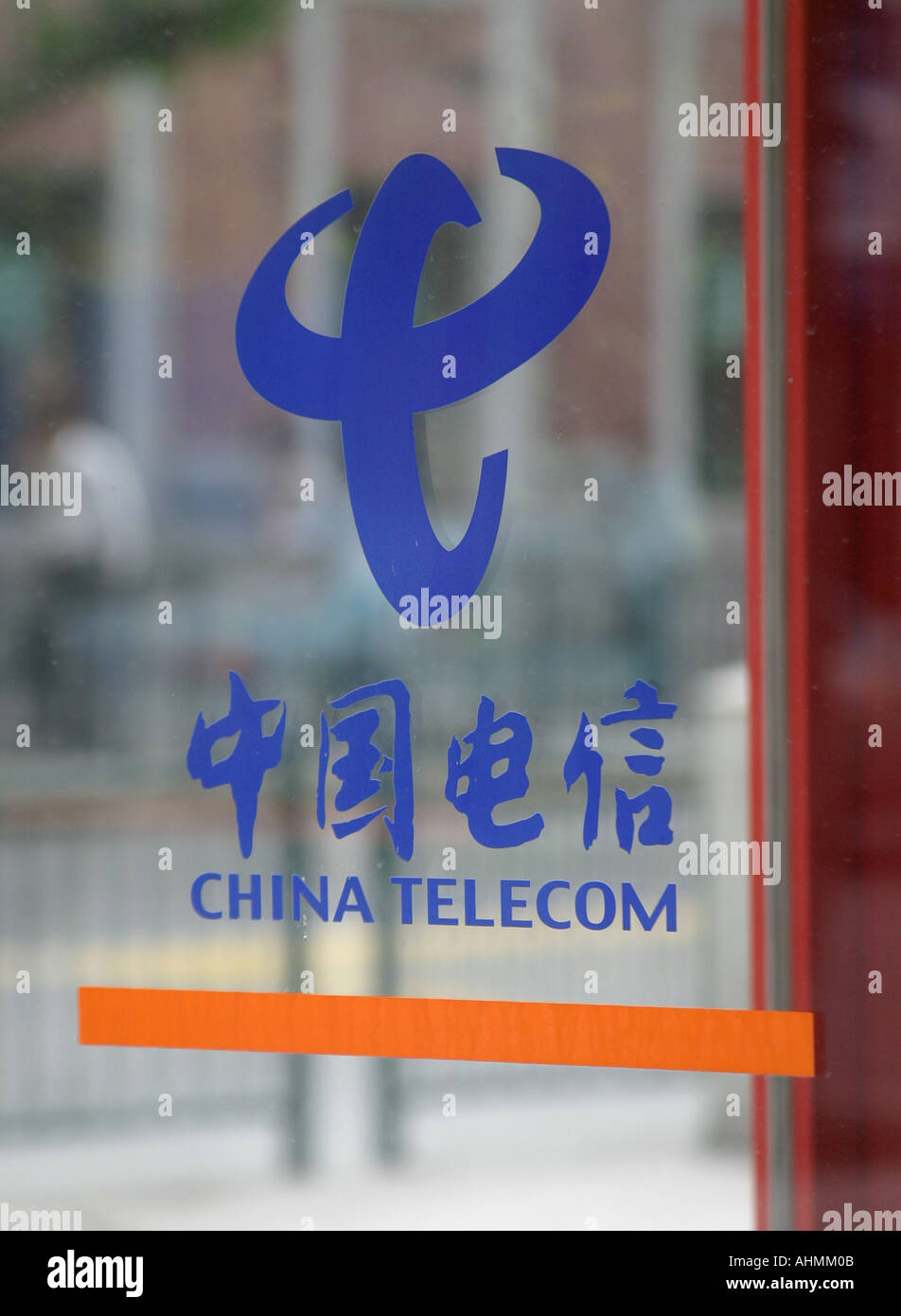 China Telecom logo on the glass door of a phone booth. - Stock Image