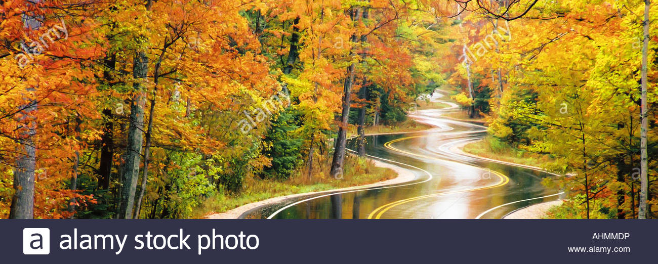 Panoramic view of winding road in autumn - Stock Image