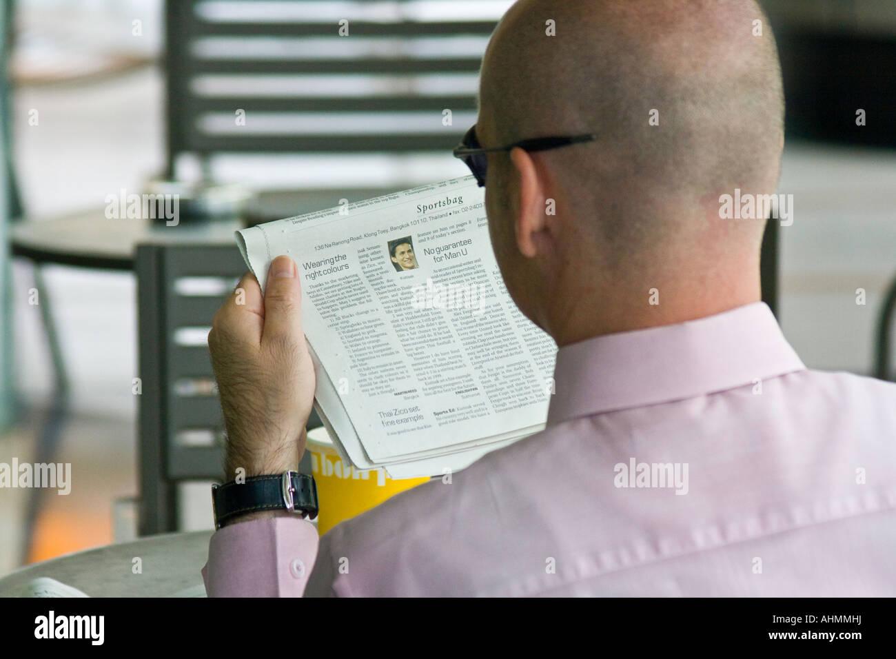 Young Professional Western Expat Man Reading Newspaper Bangkok Stock