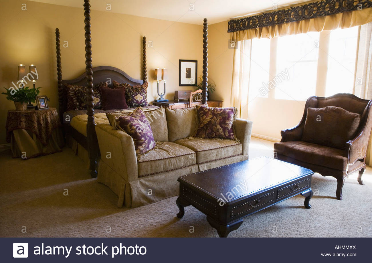 Elegant Master Bedroom with Four-post Bed - Stock Image