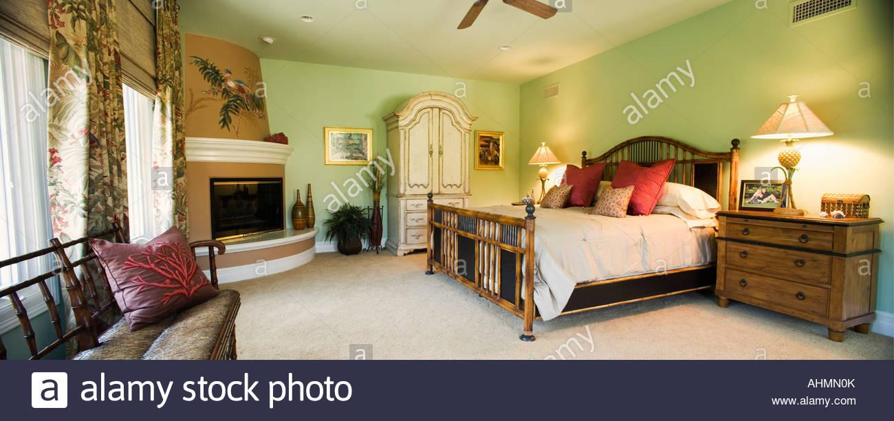 Panoramic of Beach Style Master Bedroom Stock Photo ...