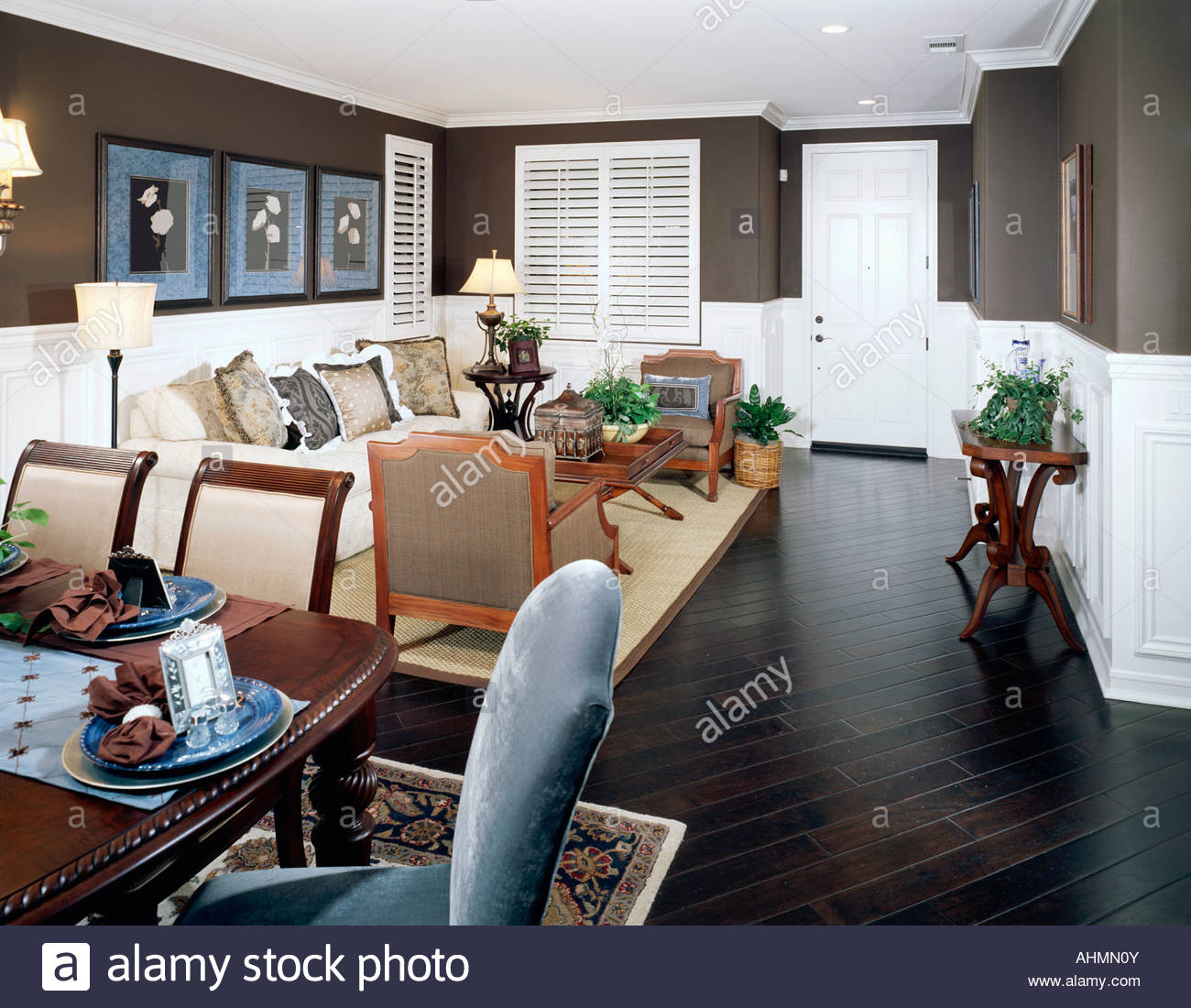 Cozy Living Room with Dark Brown Walls and Floor Stock Photo ...