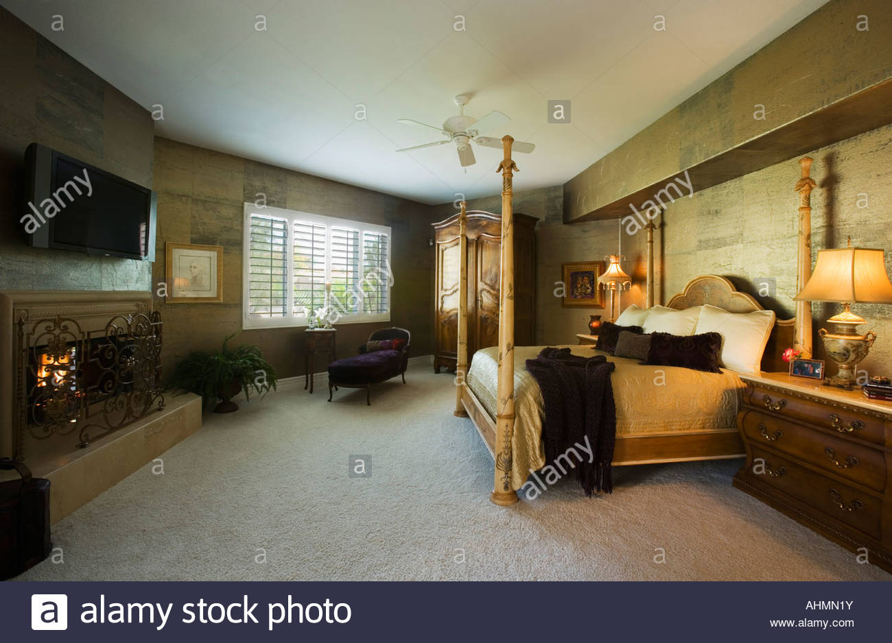 Large Master Bedroom with Four Post Bed - Stock Image