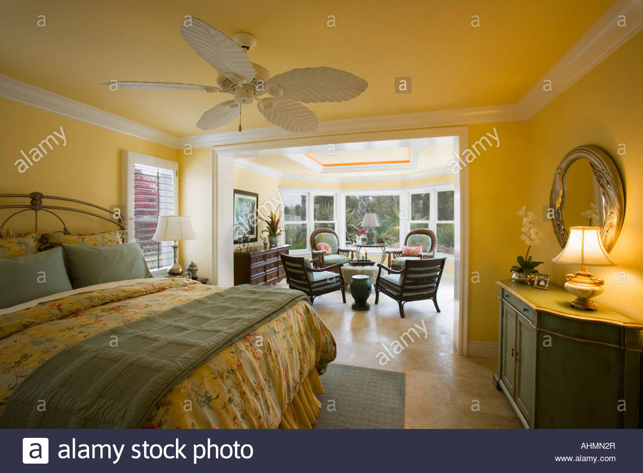 Large Yellow Master Bedroom With Sunroom Stock Photo 14507950 Alamy