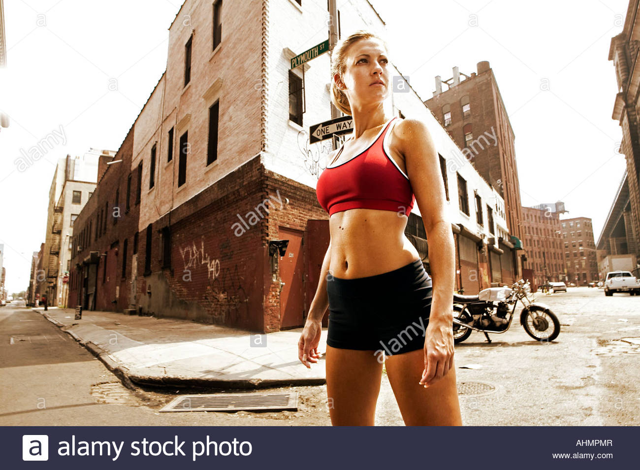 Woman athlete on urban street - Stock Image