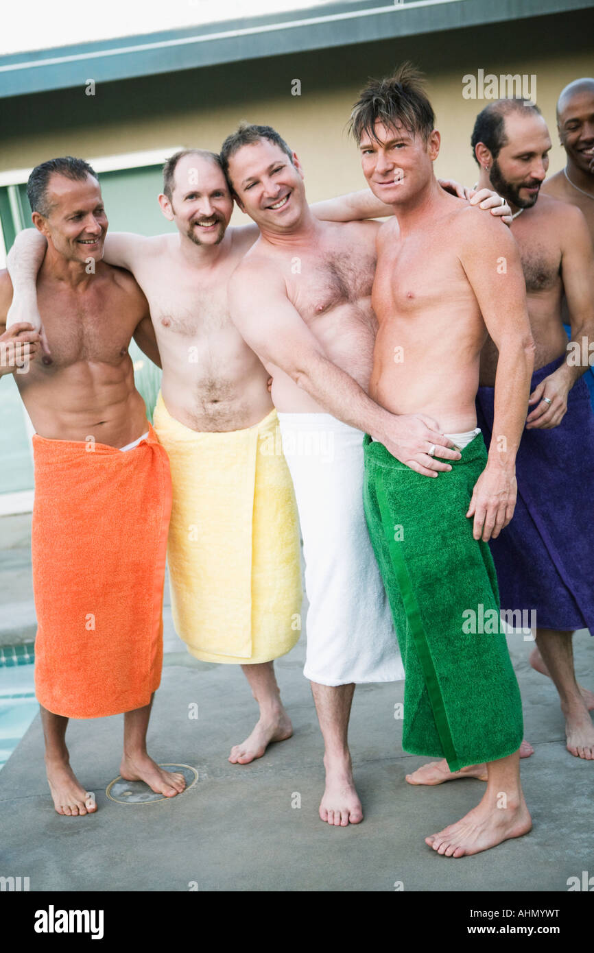 Men in towels by swimming pool Stock Photo - Alamy