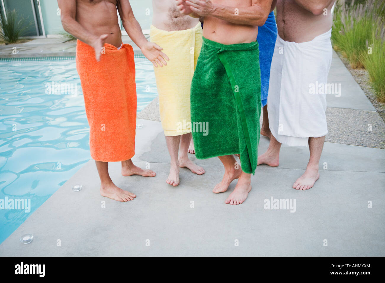 Men in towels by swimming pool Stock Photo: 14510251 - Alamy