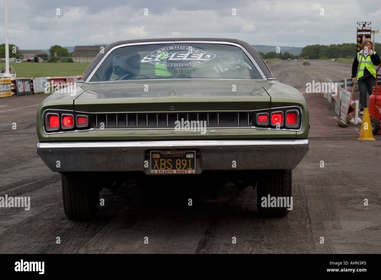 Rear View Of American Muscle Car Aproaching Start Line At Drag Race