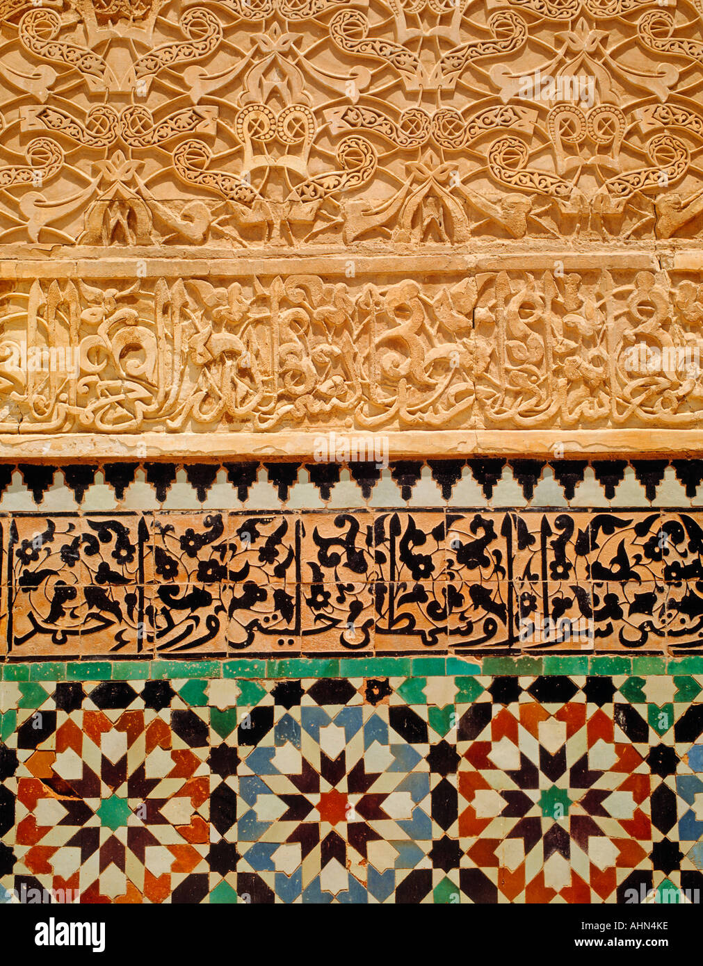 Marrakech Morocco Decorative tiles and plasterwork in Medersa Ben Youssef - Stock Image
