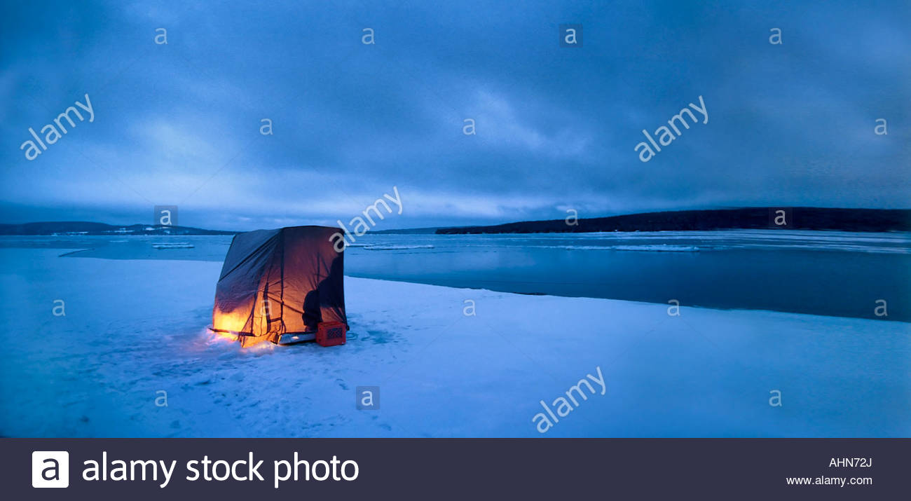 Ice fishing shelter over frozen water - Stock Image