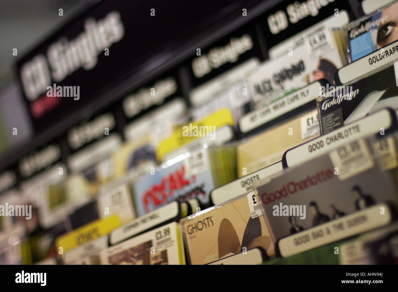 CD singles forsale in HMV Oxford Street London - Stock Image