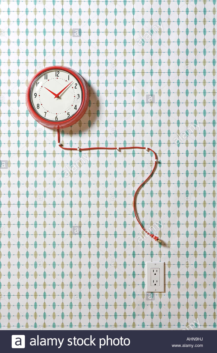 Unplugged wall clock - Stock Image