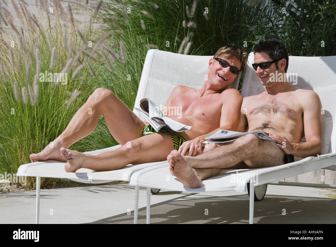 Gay Couple Relaxing By Swimming Pool