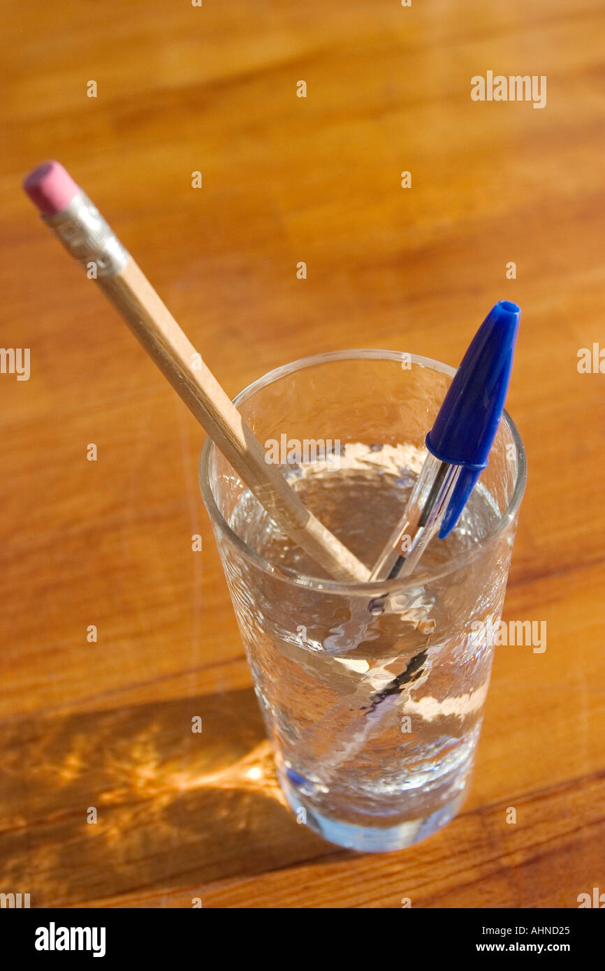 fluorescent pen and crayon in a full water glass stock photo