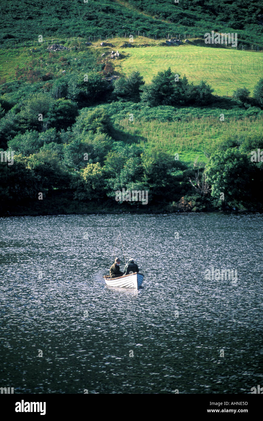 IRELAND Two Fisherman in a Boat Rippled Lake - Stock Image