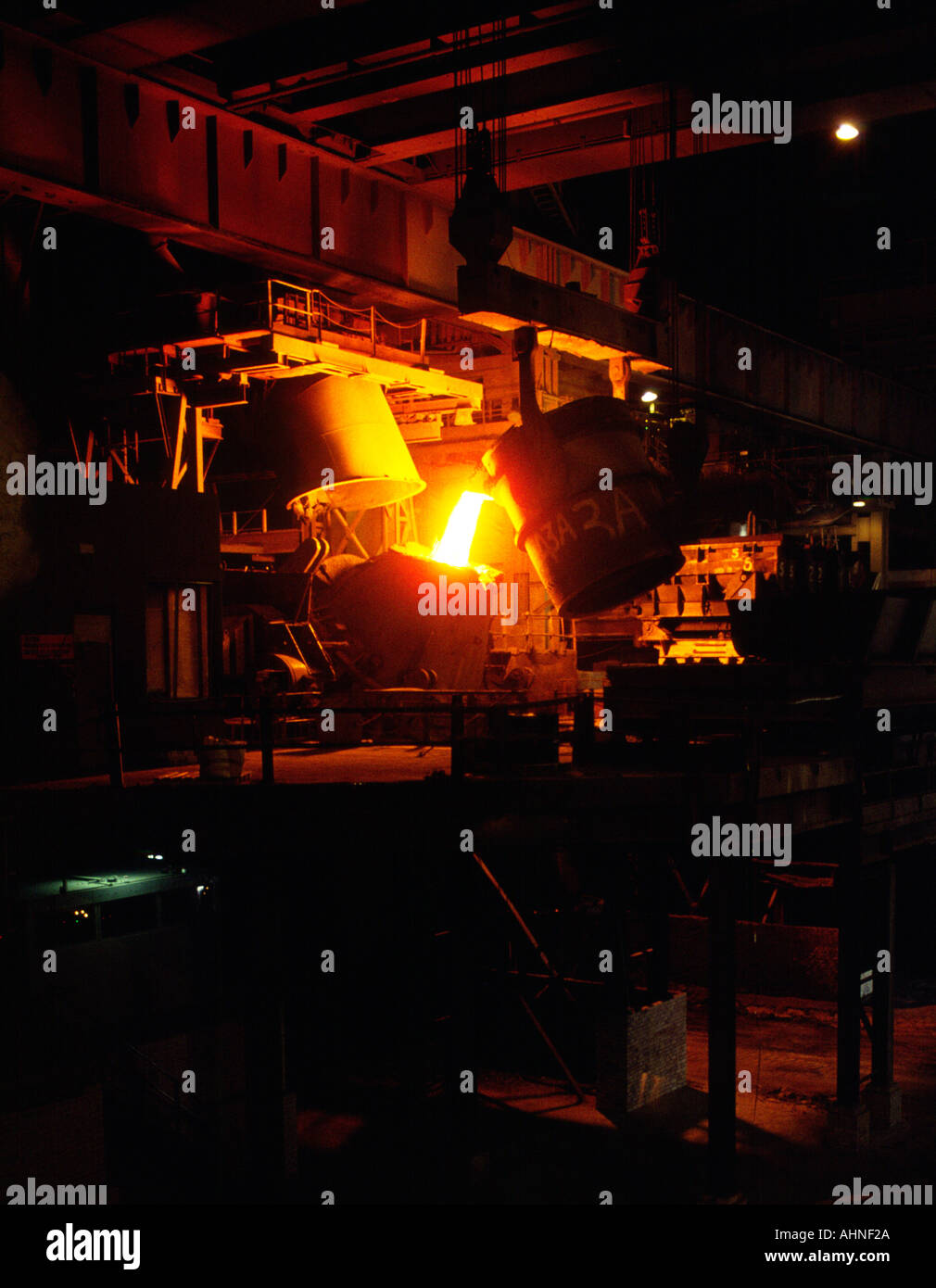 Steel furnace pouring charging molten steel into AOD vessel during stainless steel refining at British Steel Stainless Sheffield - Stock Image