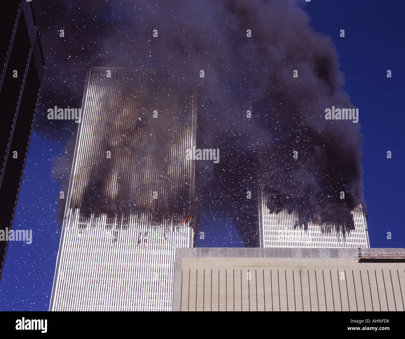 September 11 2001 the burning of the World Trade Center buildings as seen from east side of Manhattan - Stock Image