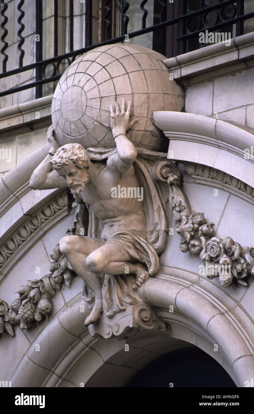 stone carving of atlas carrying the weight of the world on his shoulders on banking building in leeds uk - Stock Image