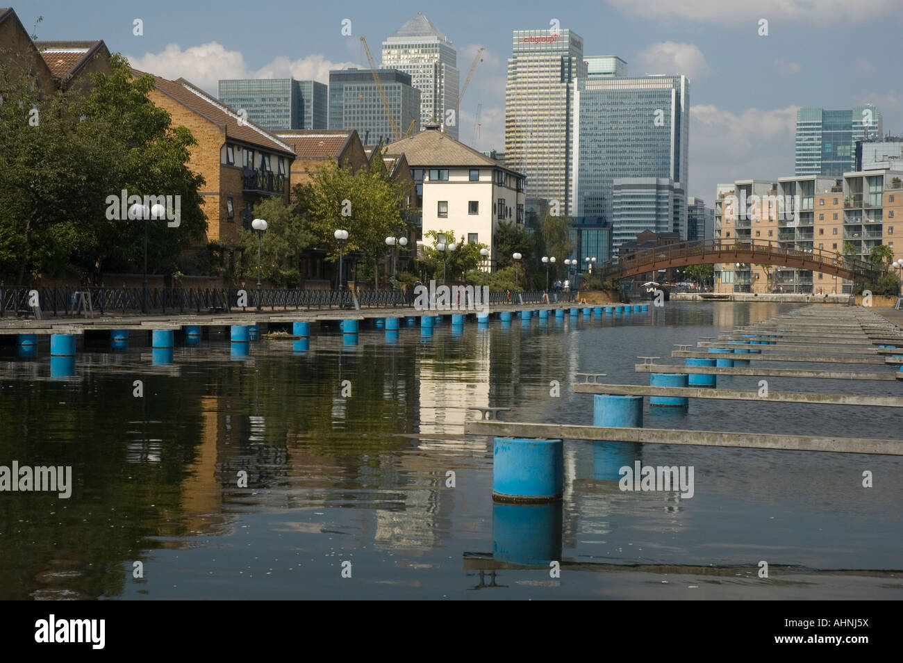Millwall Dock with Canary Wharf in the background, Isle of Dogs, East London. - Stock Image