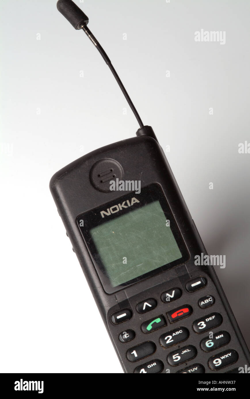 Old Nokia Cell Phone On The Orange Network Stock Photo