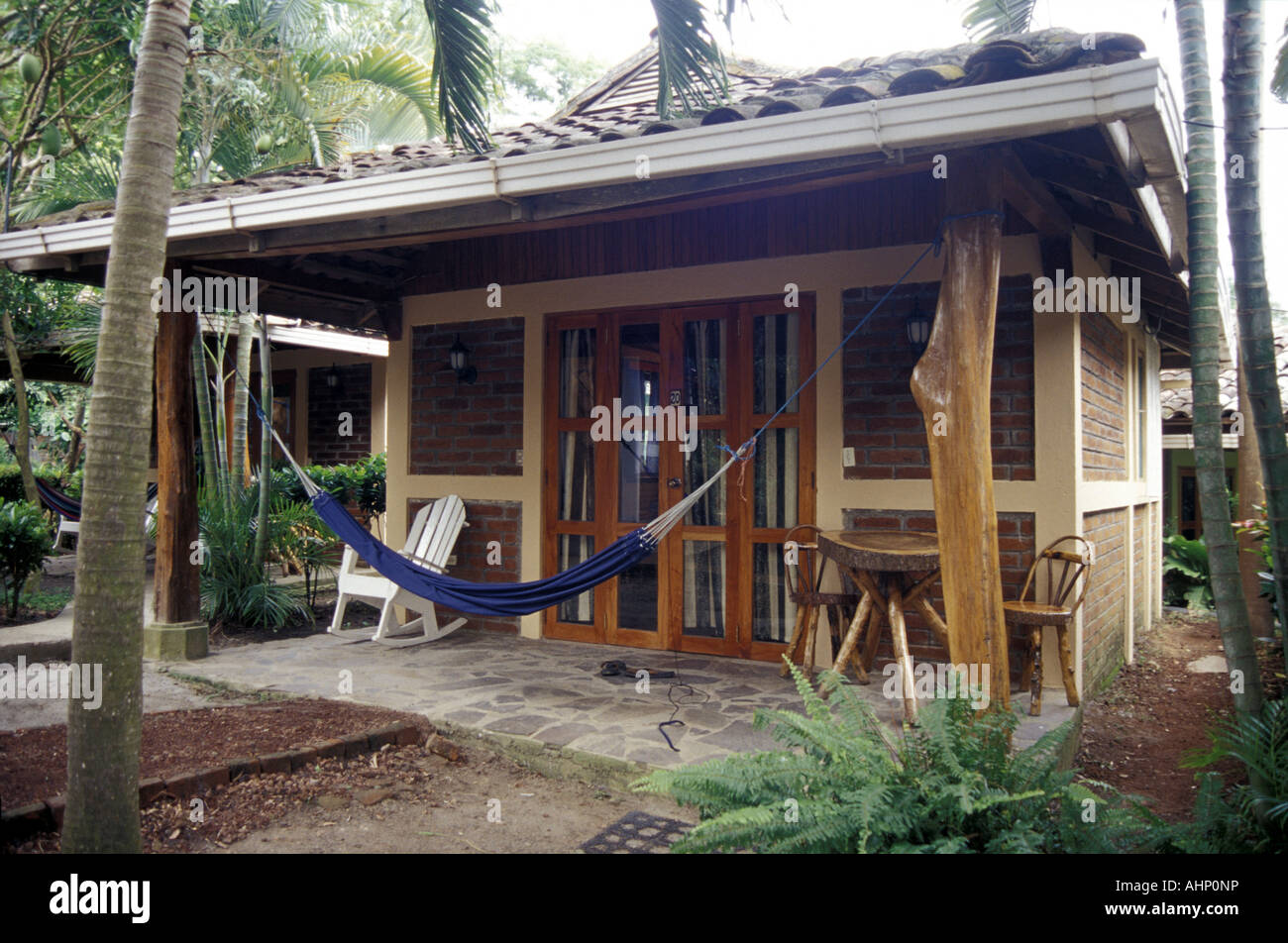 A guest cabin and hammock at the Hotel Villa Paraiso on Isla de Ometepe or Ometepe Island, Nicaragua. - Stock Image